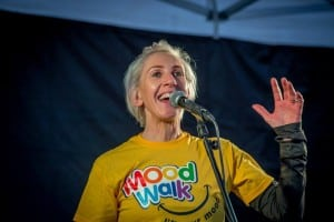Dee McCahill warming-up the crowd at the Aware Mood Walk, L'Derry.